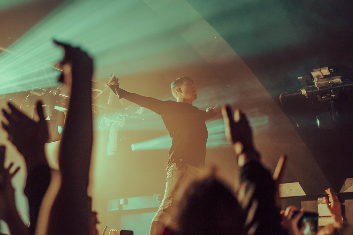 Singer of Set It Off stood on the crowd, performing at London Garage