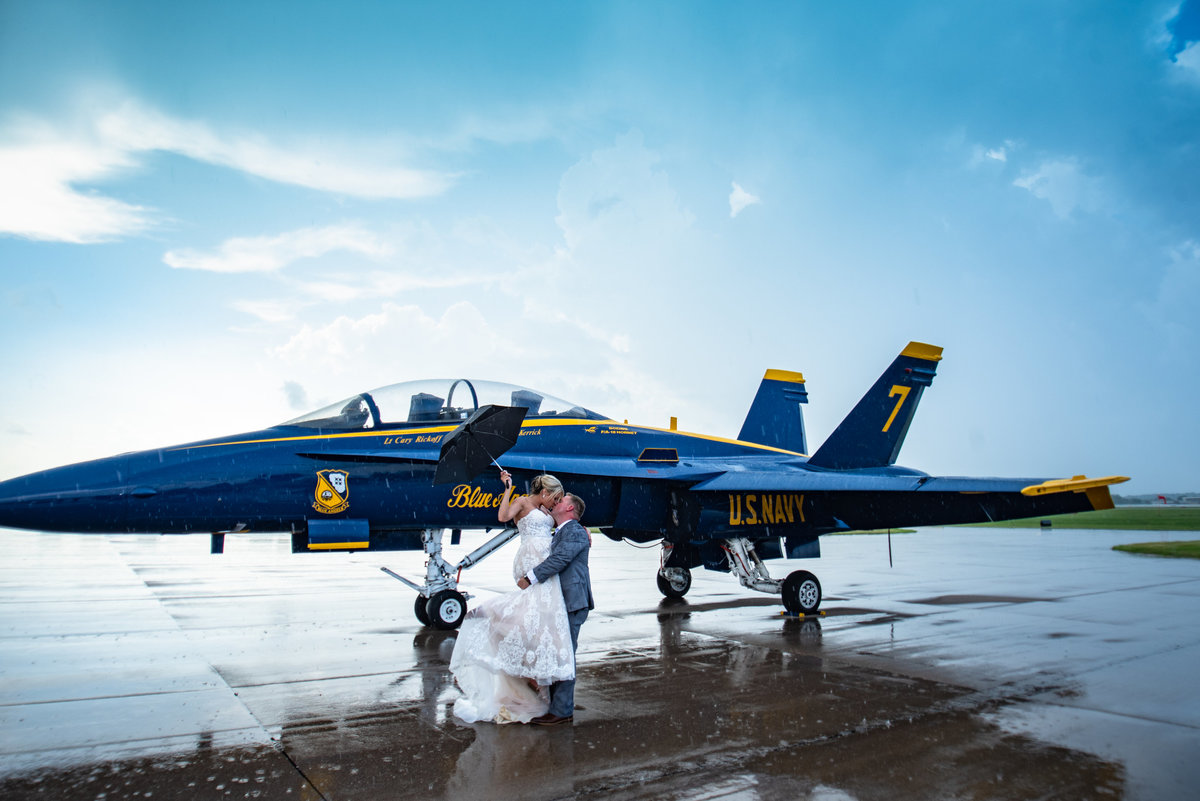 Blue Angels jet Quad Cities Air show Bride and Groom kiss in the rain