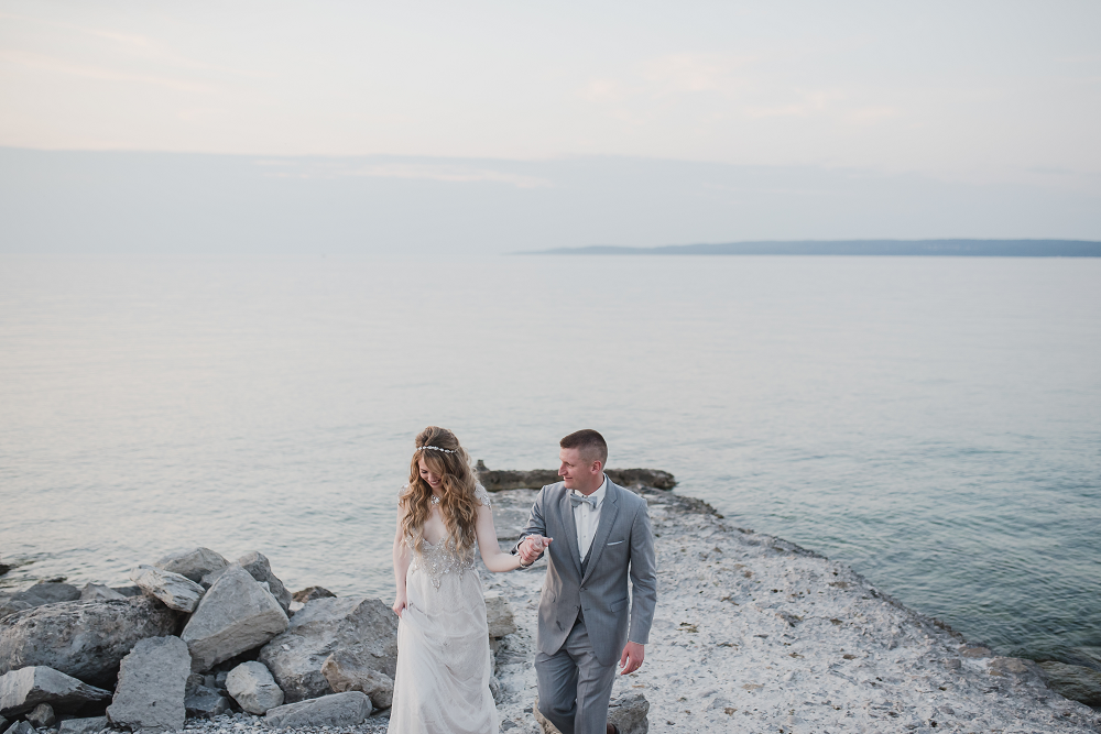 Bride and Groom on beach  in Front of Water Lake Michigan Wedding