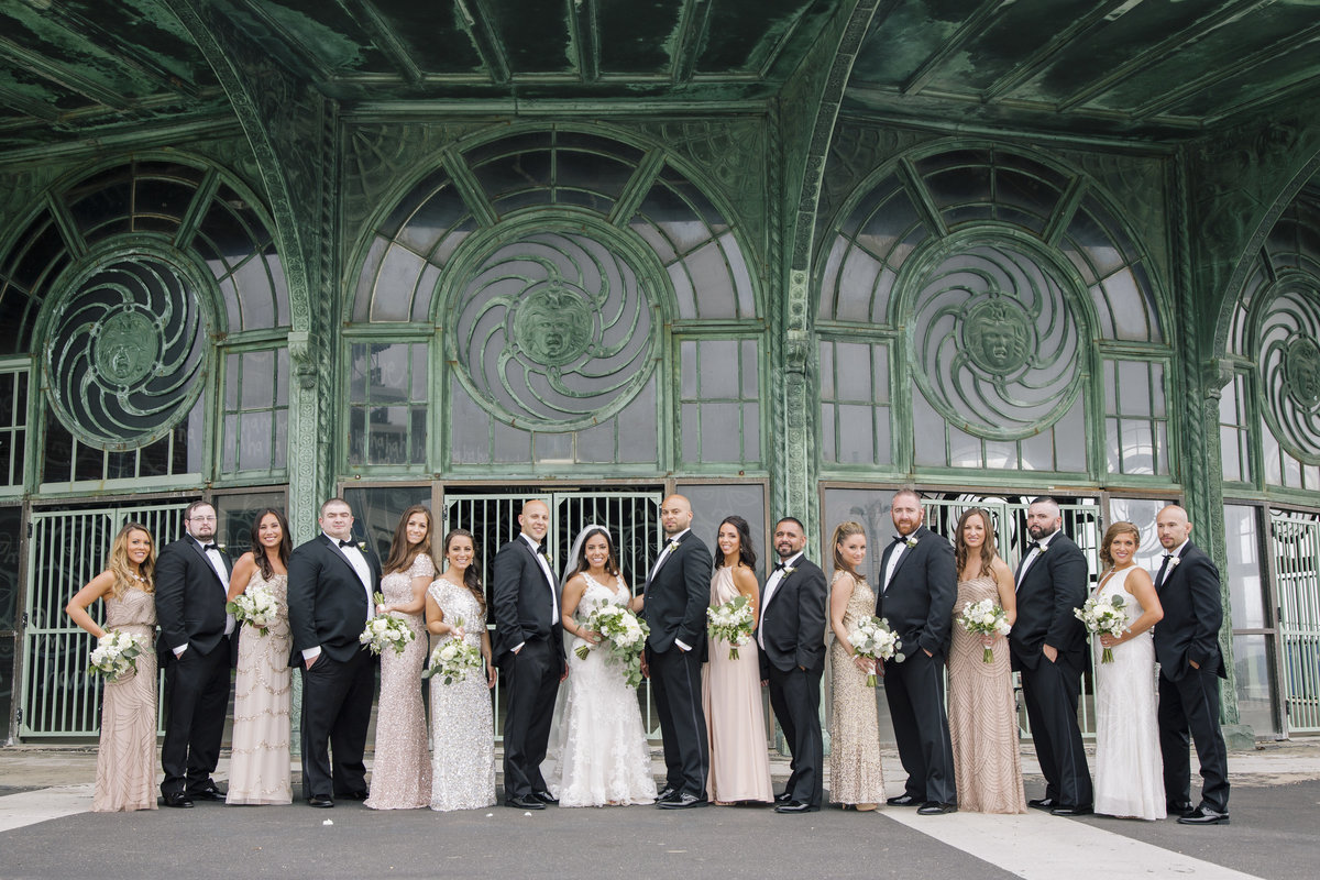 bridal party in front of carousel  at asbury park wedding