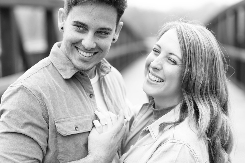Couple laughing in engagement photos