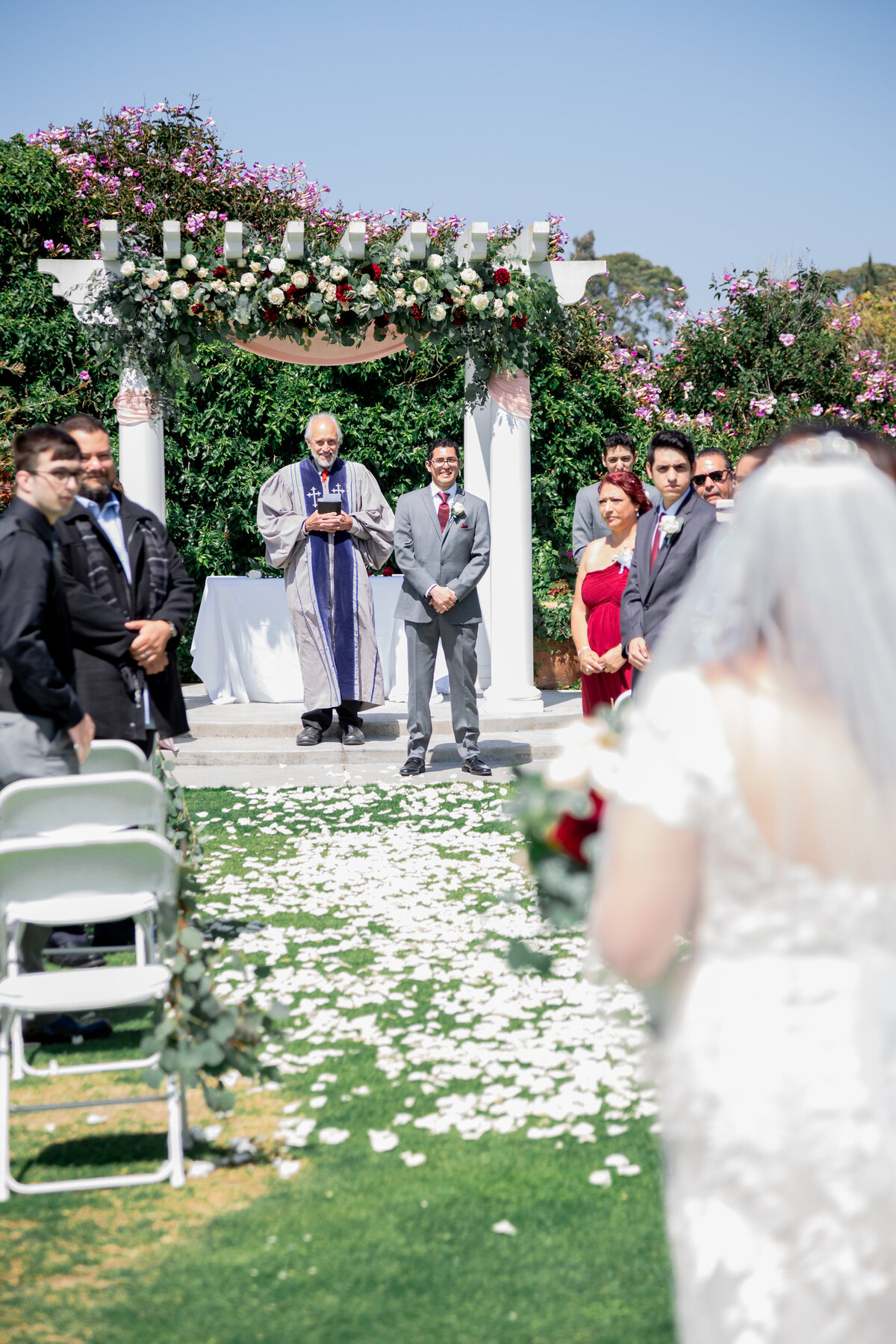 groom watching bride from brides perspective
