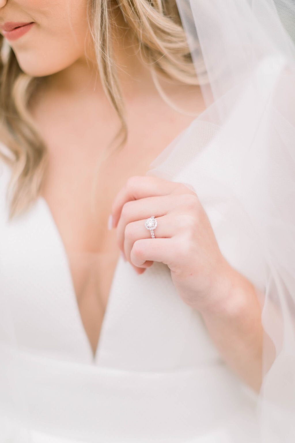 Fine Art details of bridal gown and engagement ring