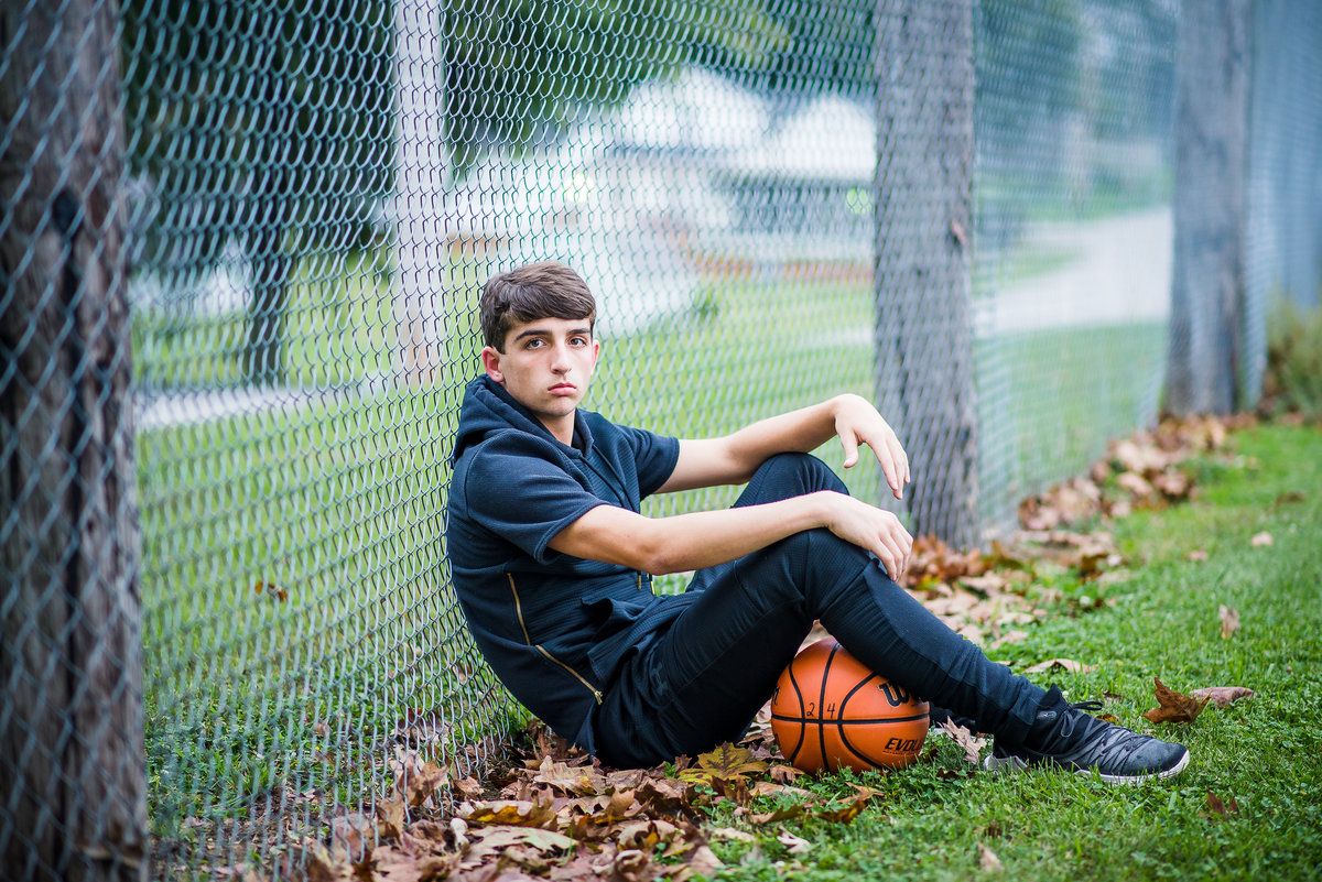 Senior Session Boys Basketball Park Fence