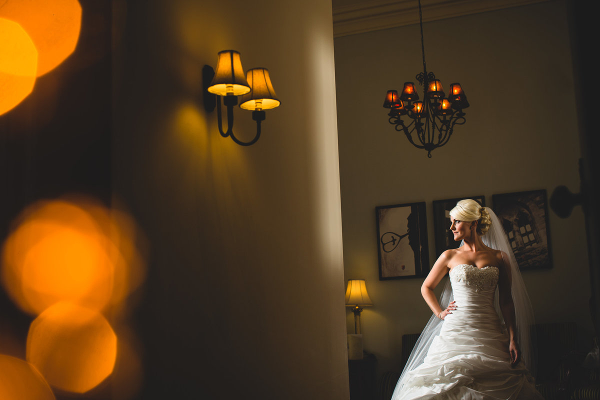 bridal portrait in hotel room at peckforton castle