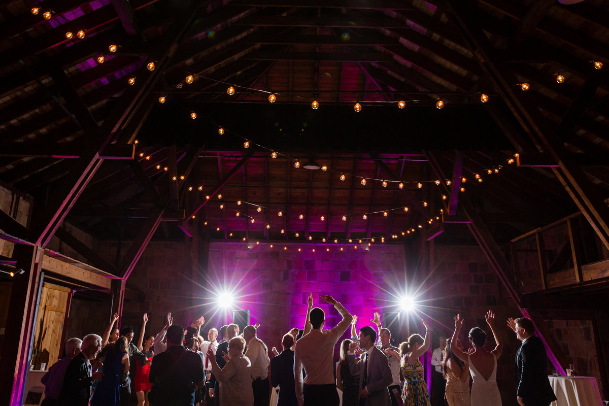 The party at the Barn at Crane Estate is in full effect with this wedding reception