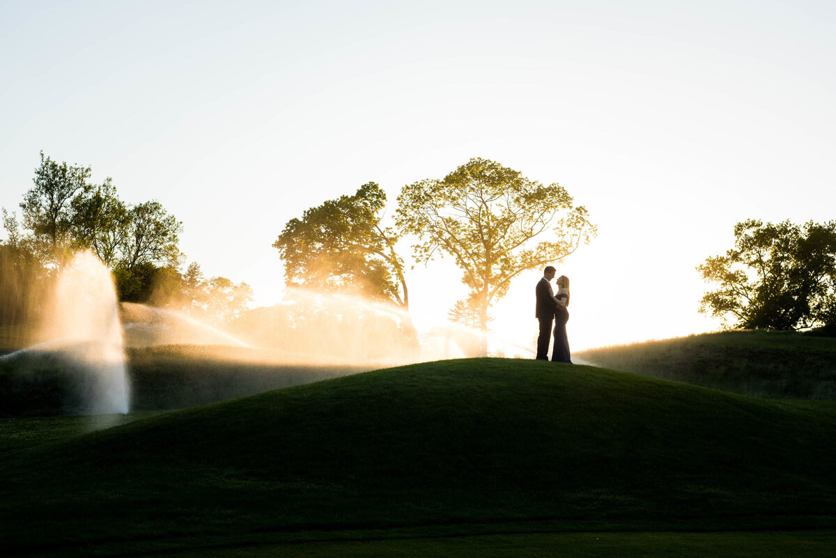 engaged couple on a golf course