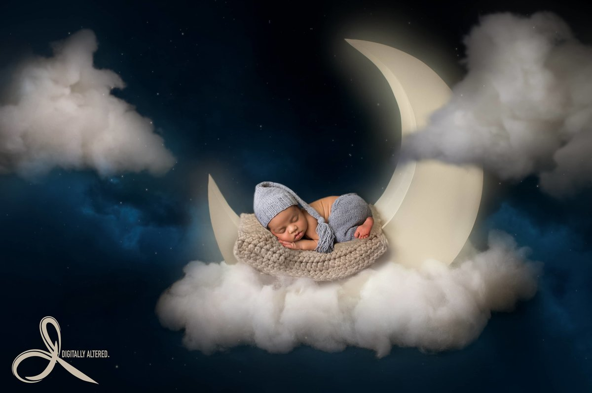 Little boy lying on the moon