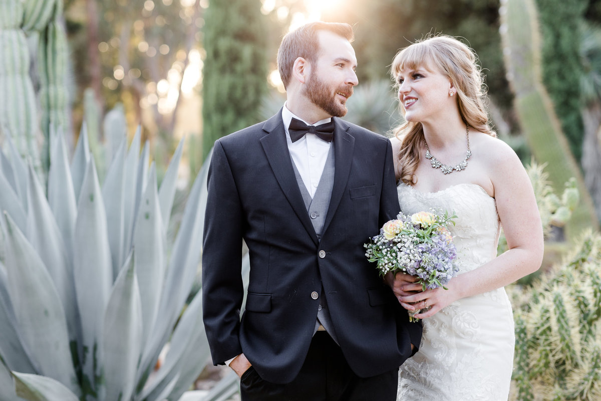 Bride and groom gaze into each others' eyes during sunset in a cactus garden in the the Bay Area