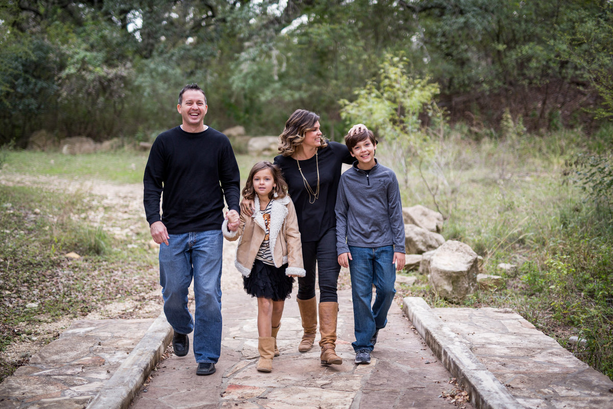 family walking on a bridge at Walker Ranch by San Antonio photographer Expose The Heart