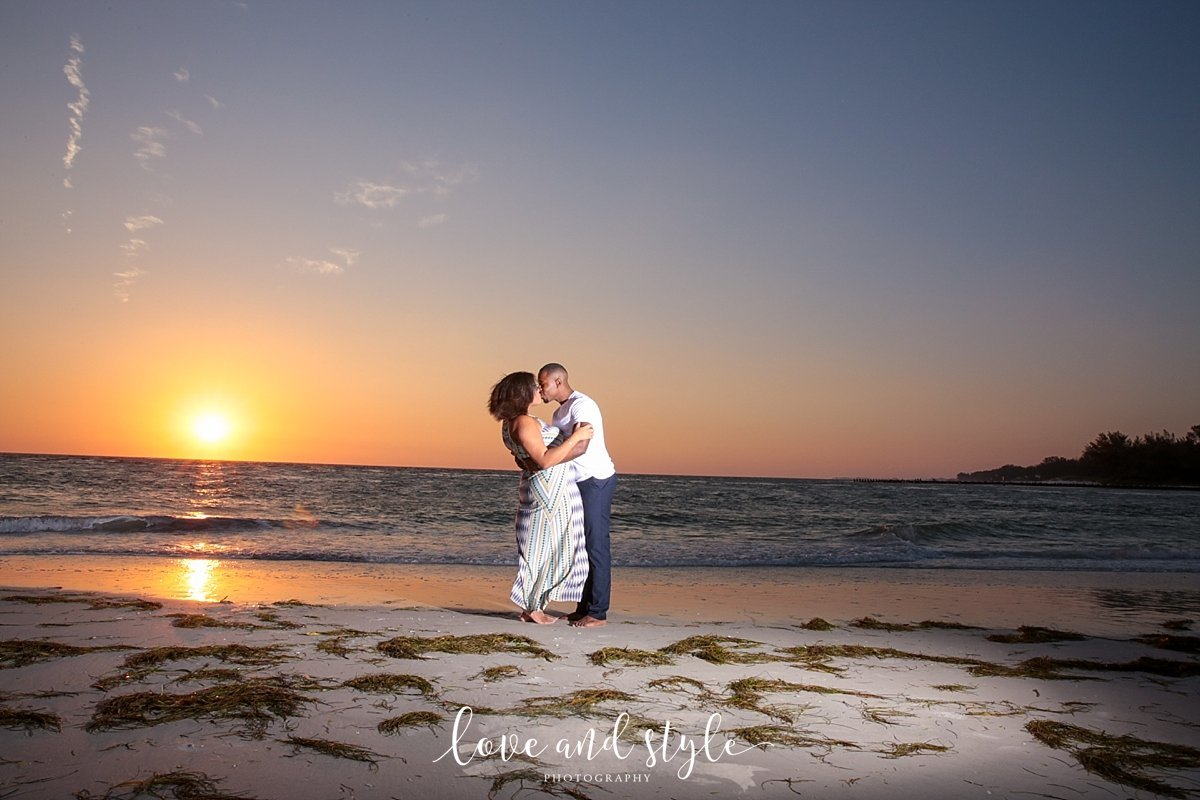 Bradenton Engagement Photography of couple kissing  on Beer Can Island at sunset