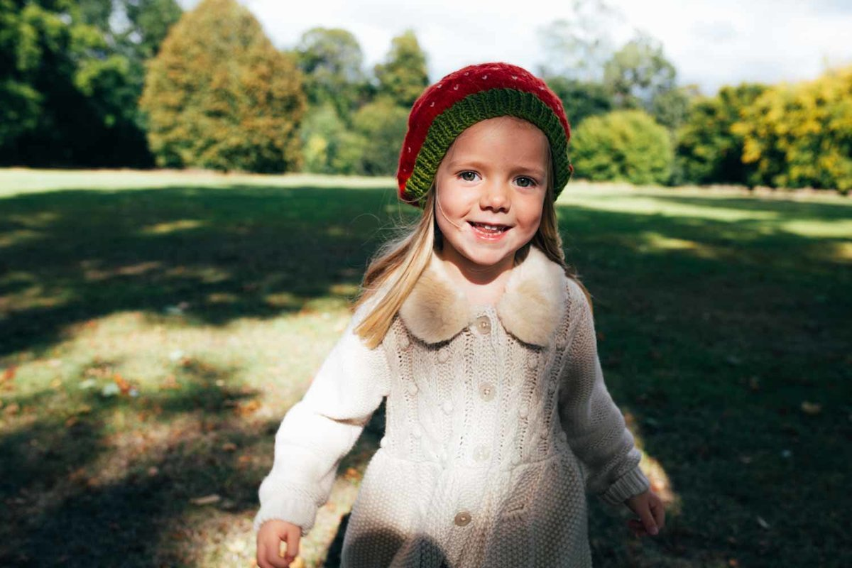Natural photograph of toddler girl playing in the park in Ipswich