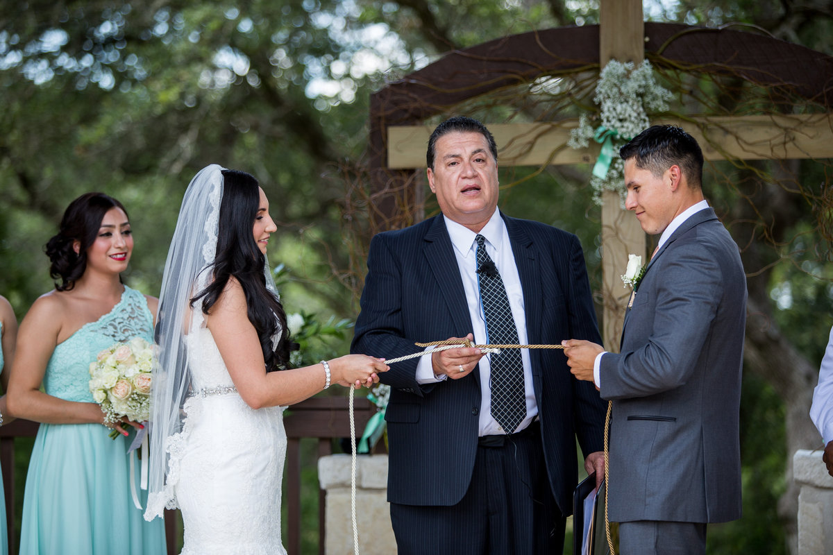 bride and groom tie the knot rope ceremony at wedding at the milestone venue