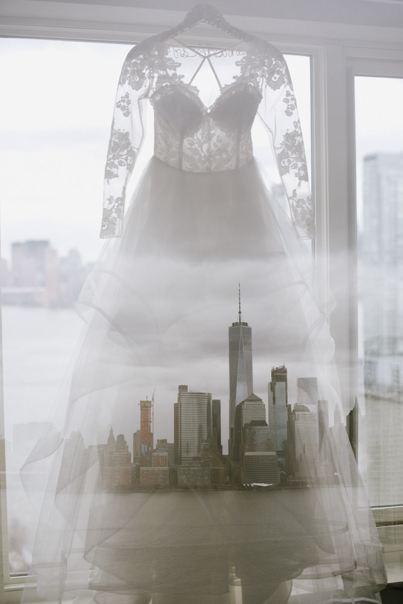 double exposure photography with the NYC skyline and a lace wedding gown