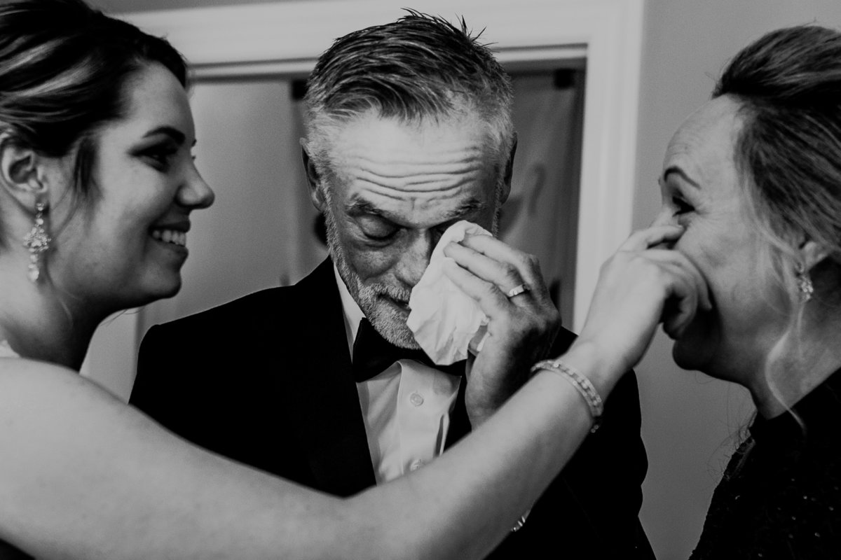 a Bride wipes a tear away after she is married