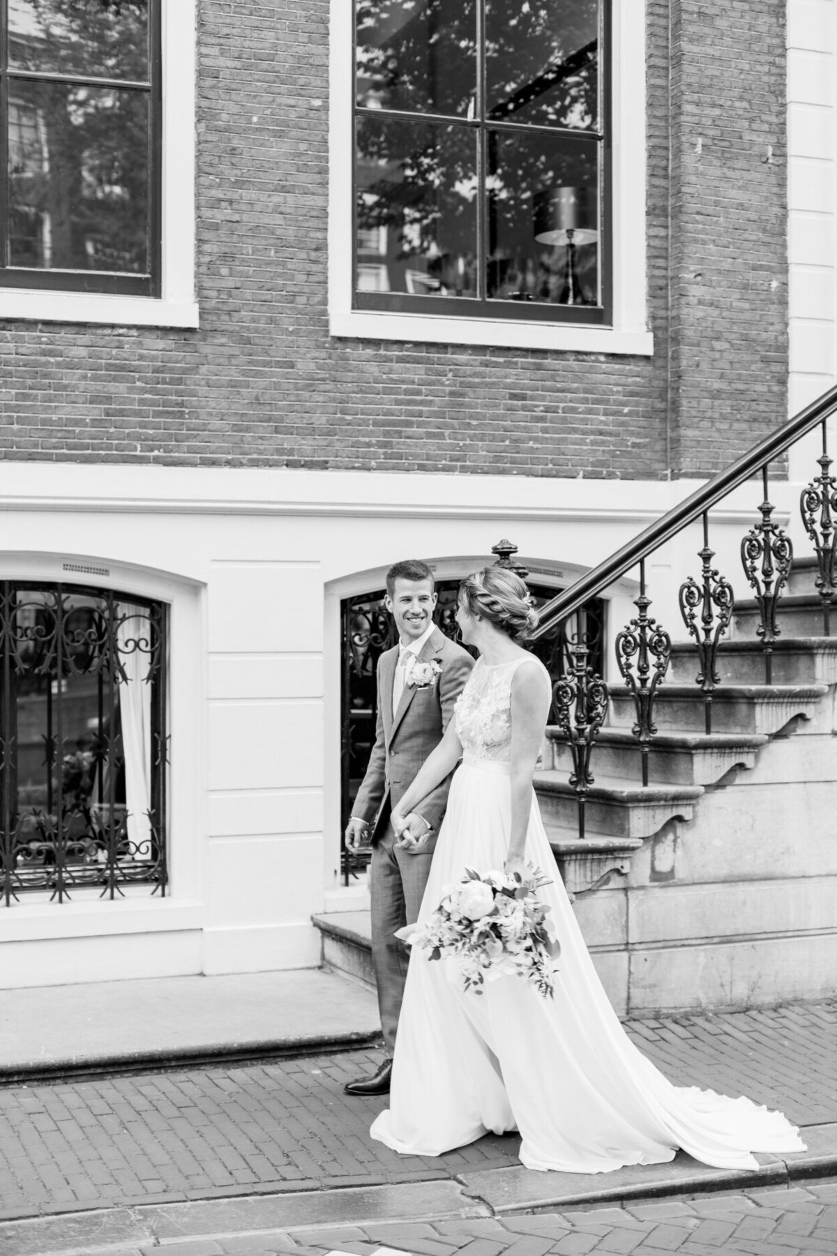 Black and white wedding portrait of the bride and groom in Amsterdam for their city elopement for a photoshoot organized by Lovely & Planned