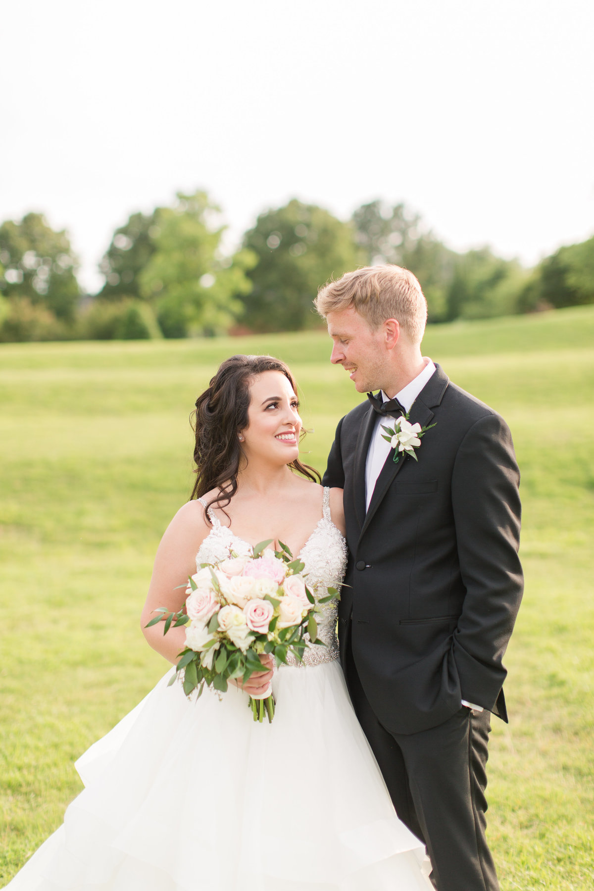 Bride and groom smiling together at Lewis Ginter Botanical Gardens wedding