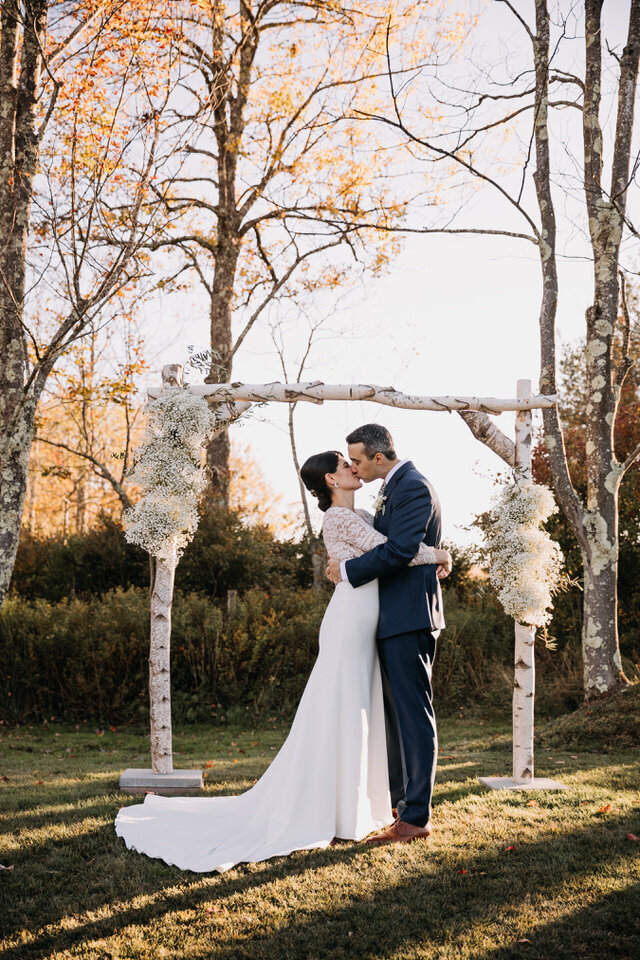 Bride and Groom Kiss Fall Wedding Arch Arnold House Livingston Manor Wedding Catskills Wedding Planner Canvas Weddings
