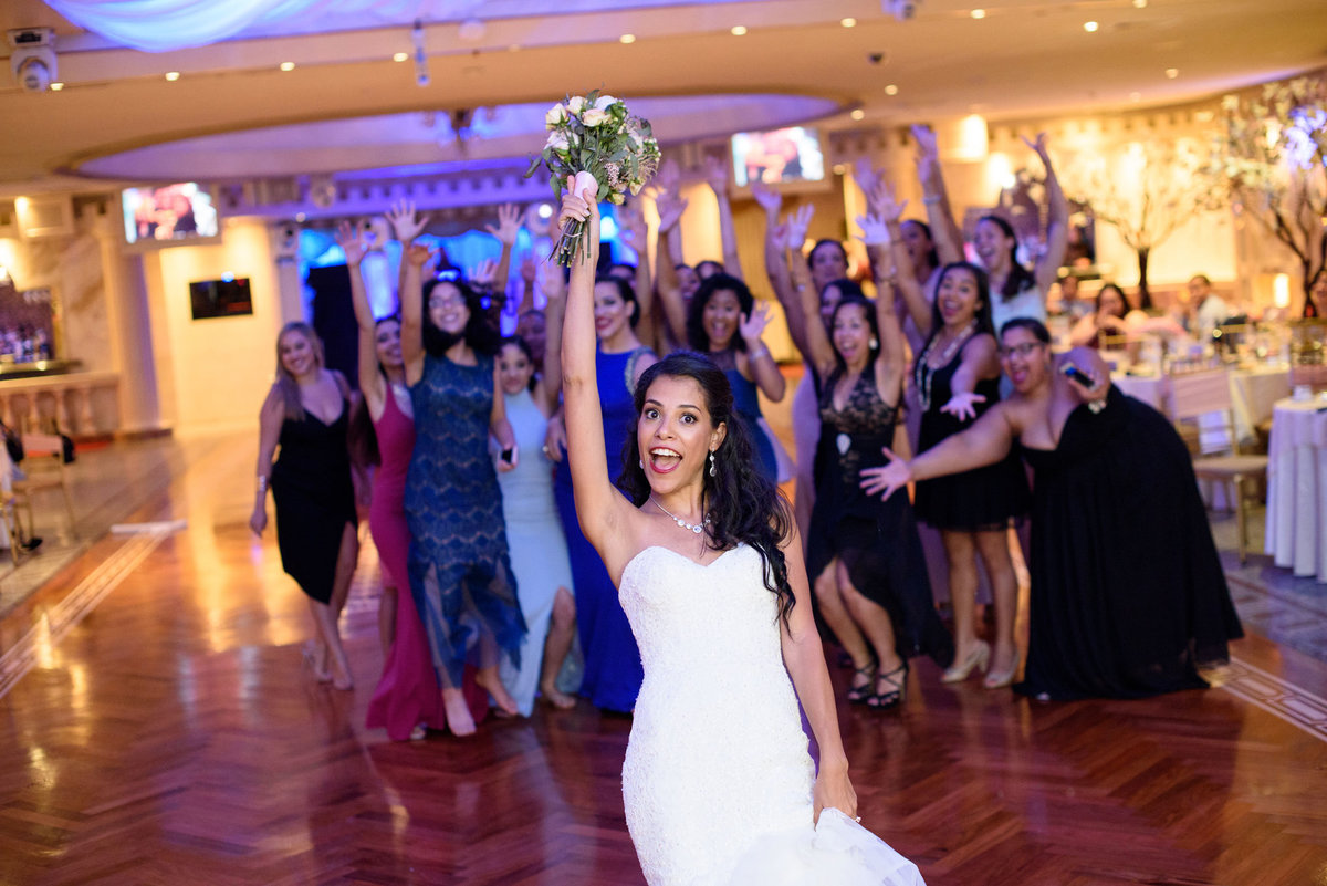 Bride throwing the bouquet at The Sands