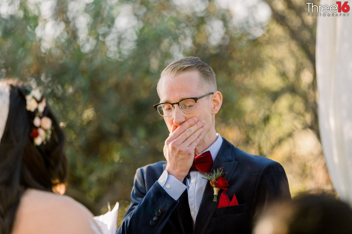 Groom holds it together during the wedding ceremony