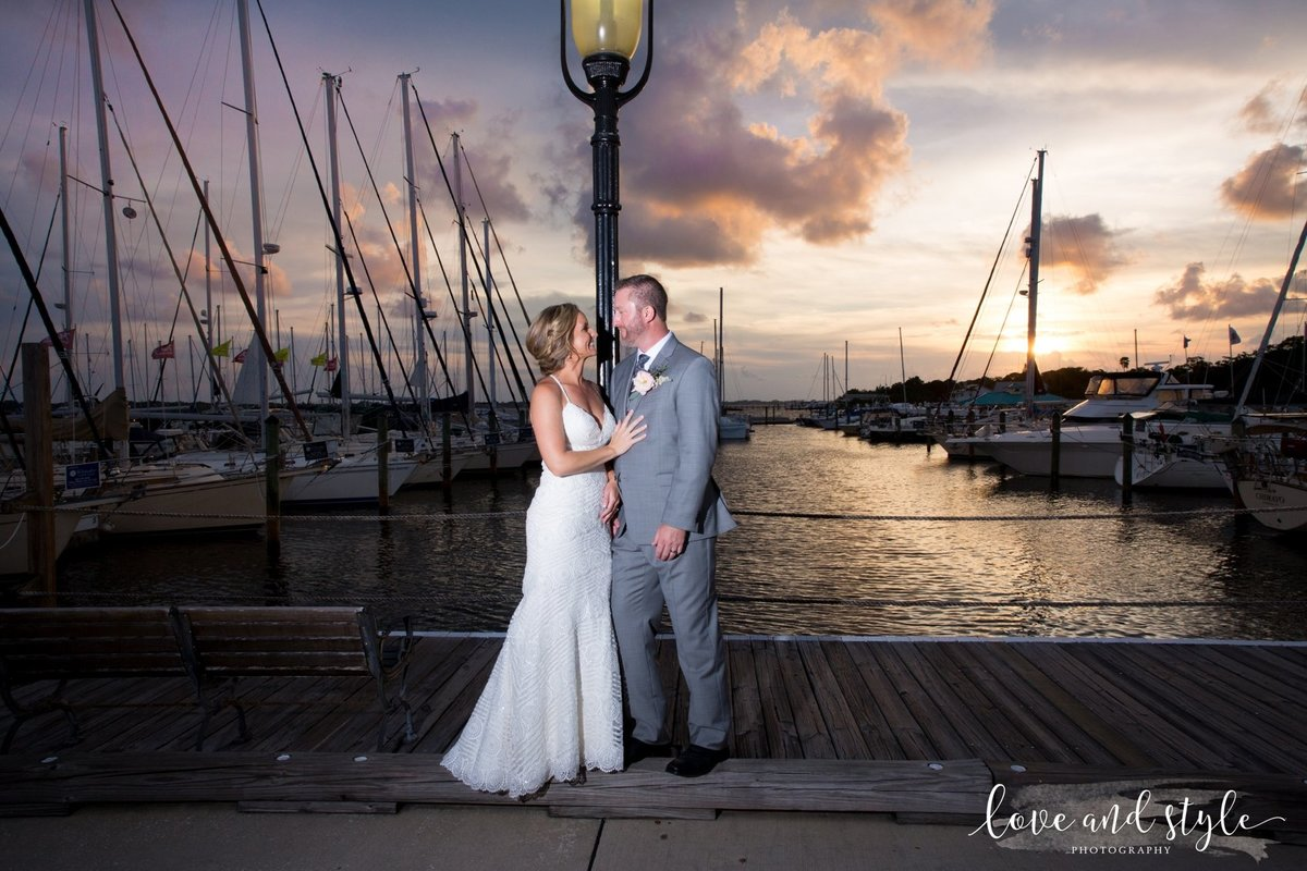 Riverhouse Palmetto Wedding Photography bride and groom portrait on the dock at sunset