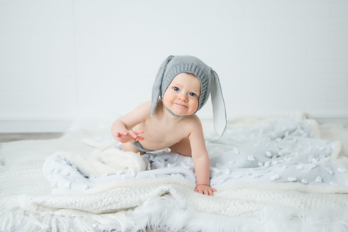 baby boy in bunny hat crawling toward camera {Oakville Baby Photographer}