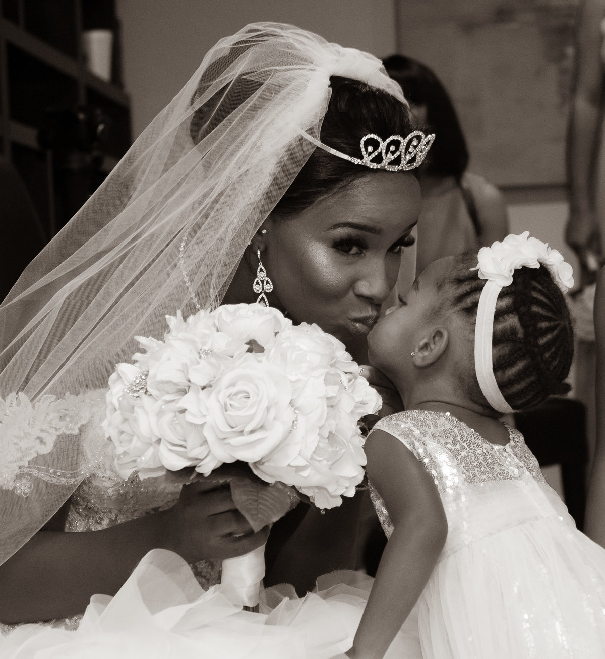 Mother Kissing Daughter before wedding