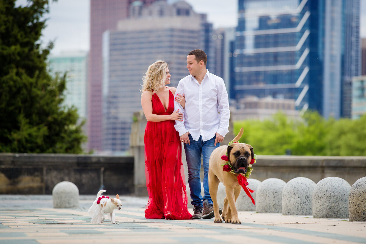 engaged couple walks with their two dogs at their Philadelphia engagement session