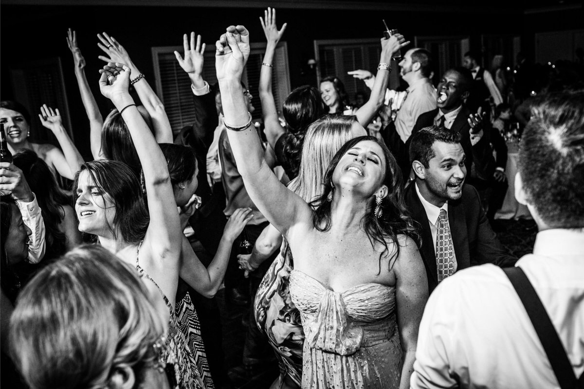 Guests dance together during a Blumen Gardens wedding reception.
