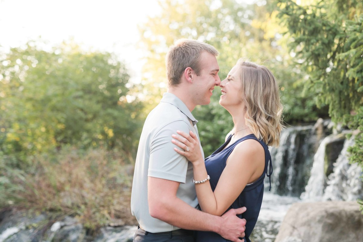 Engagement pose with waterfall background.