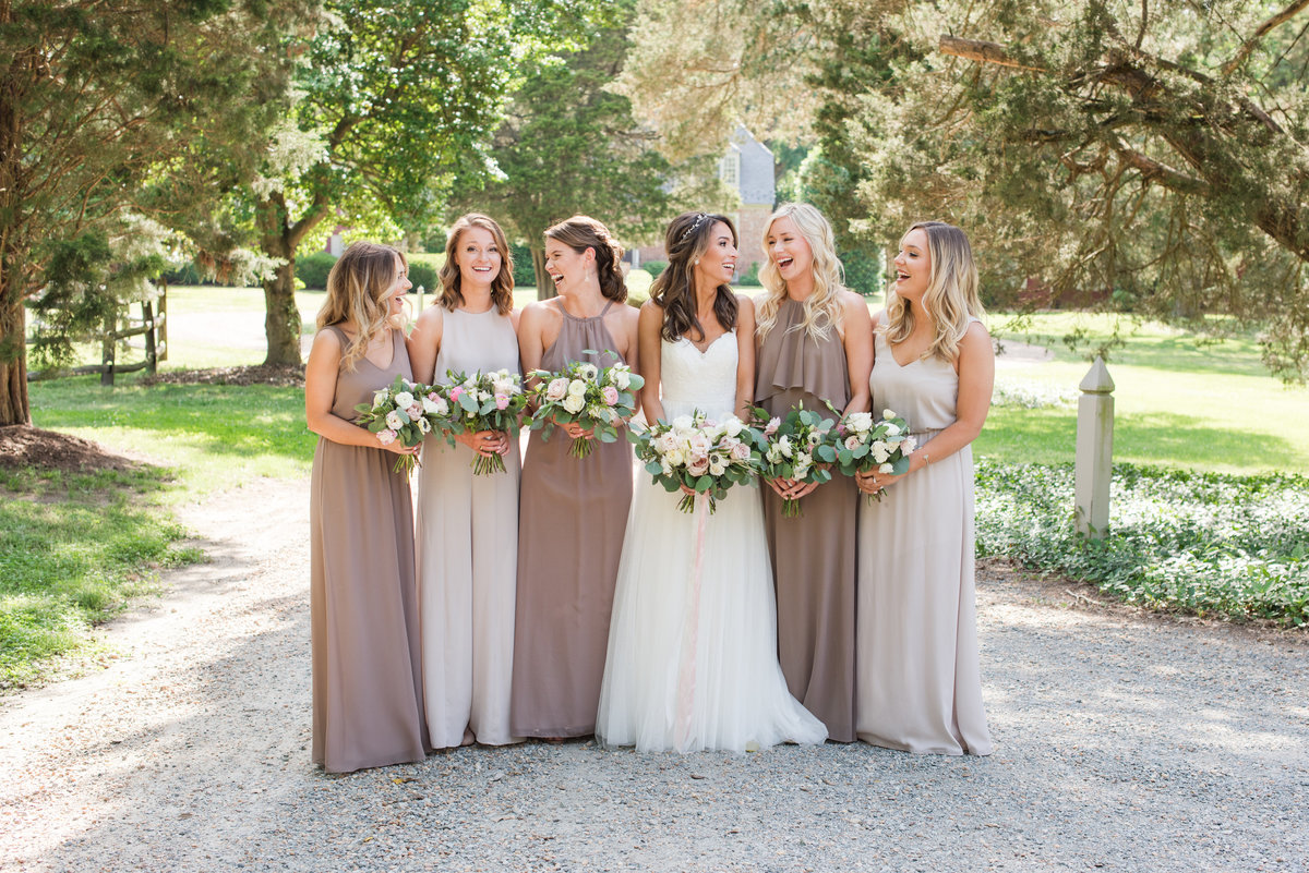Bridesmaids in neutrals at estate wedding