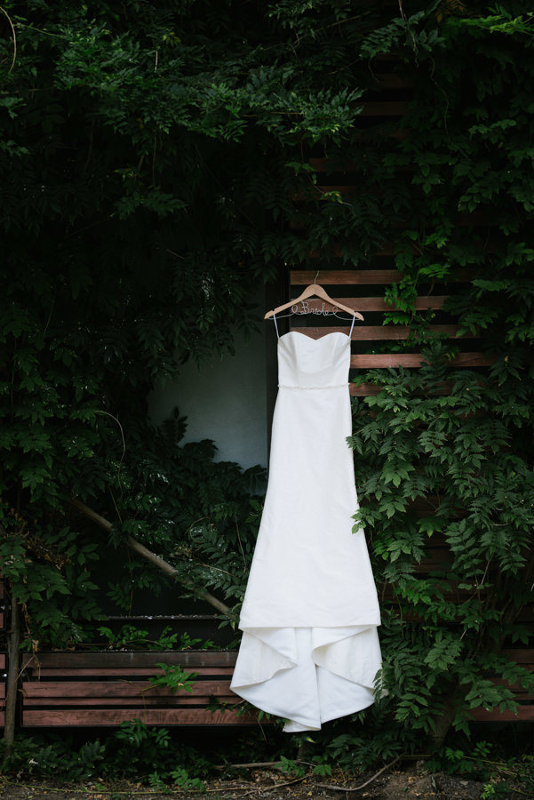 simple elegant wedding gown outside
