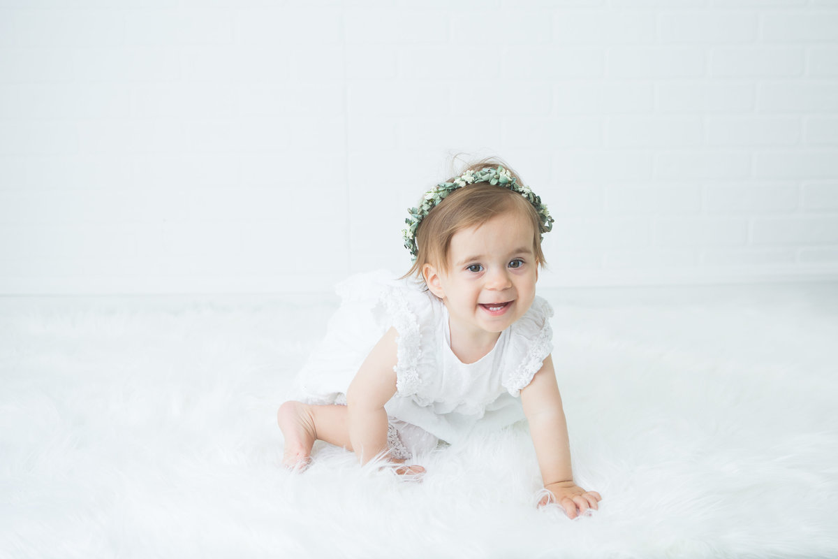 baby girl crawling towards camera in studio {Milton Baby Photographer}