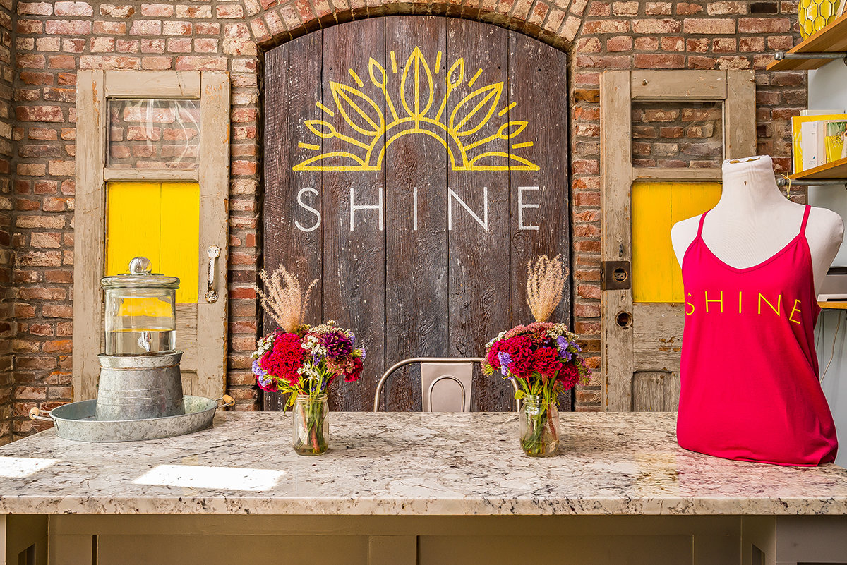 Shine Yoga welcome desk signage by KB Design