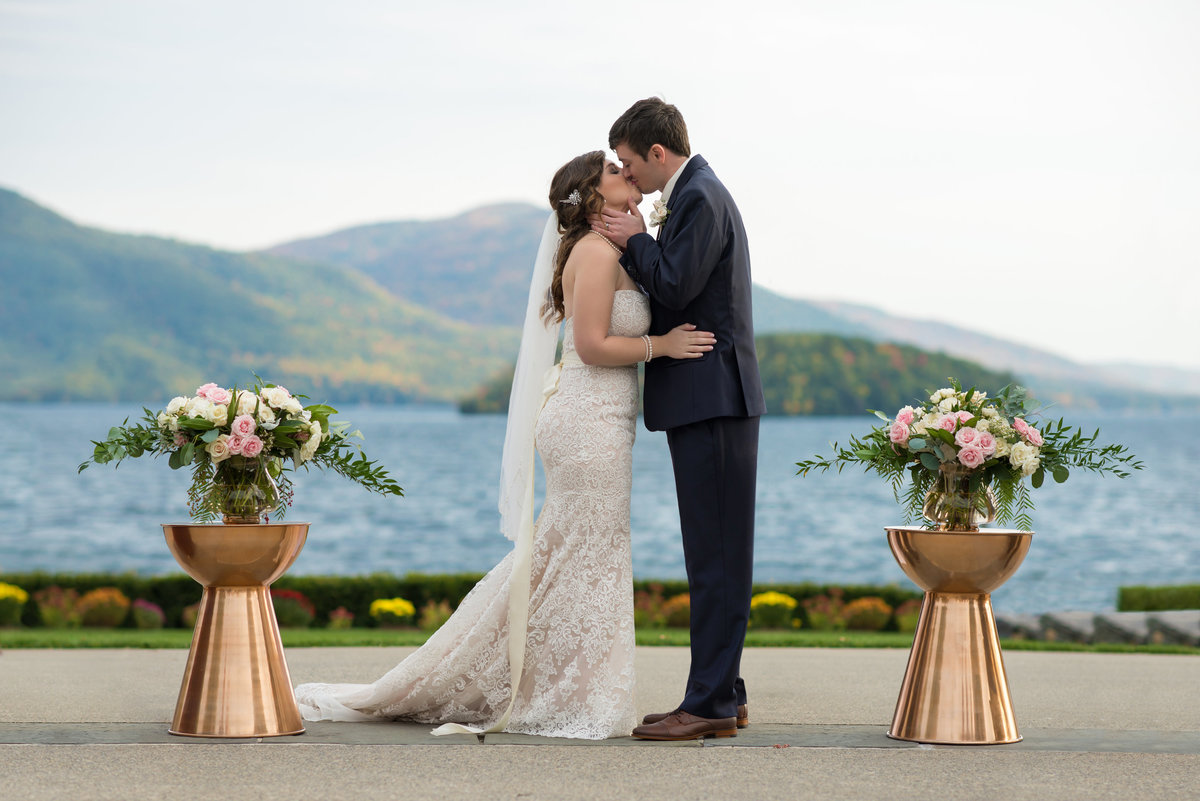Bride and Groom first kiss at Sagamore Resort on Lake George, NY