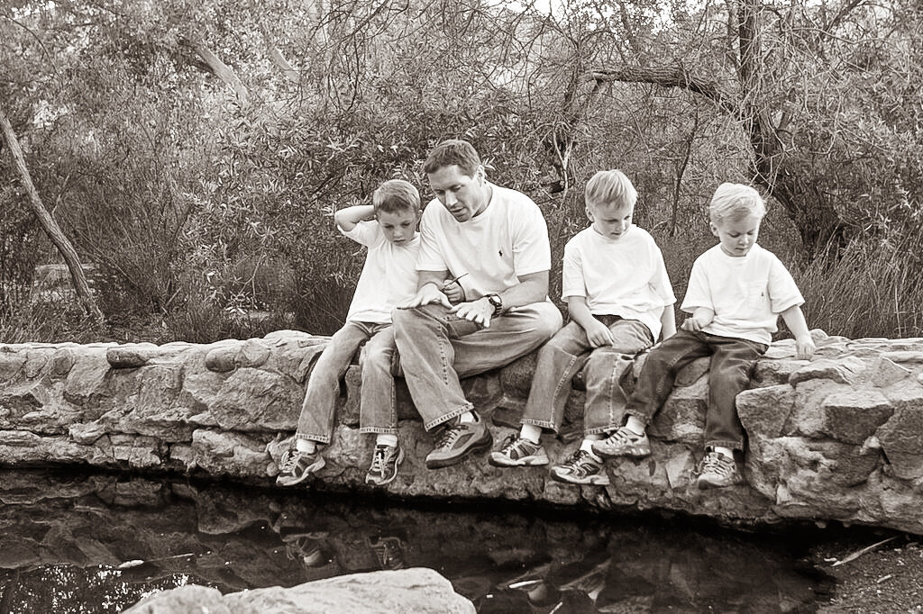 dad with sons in nature