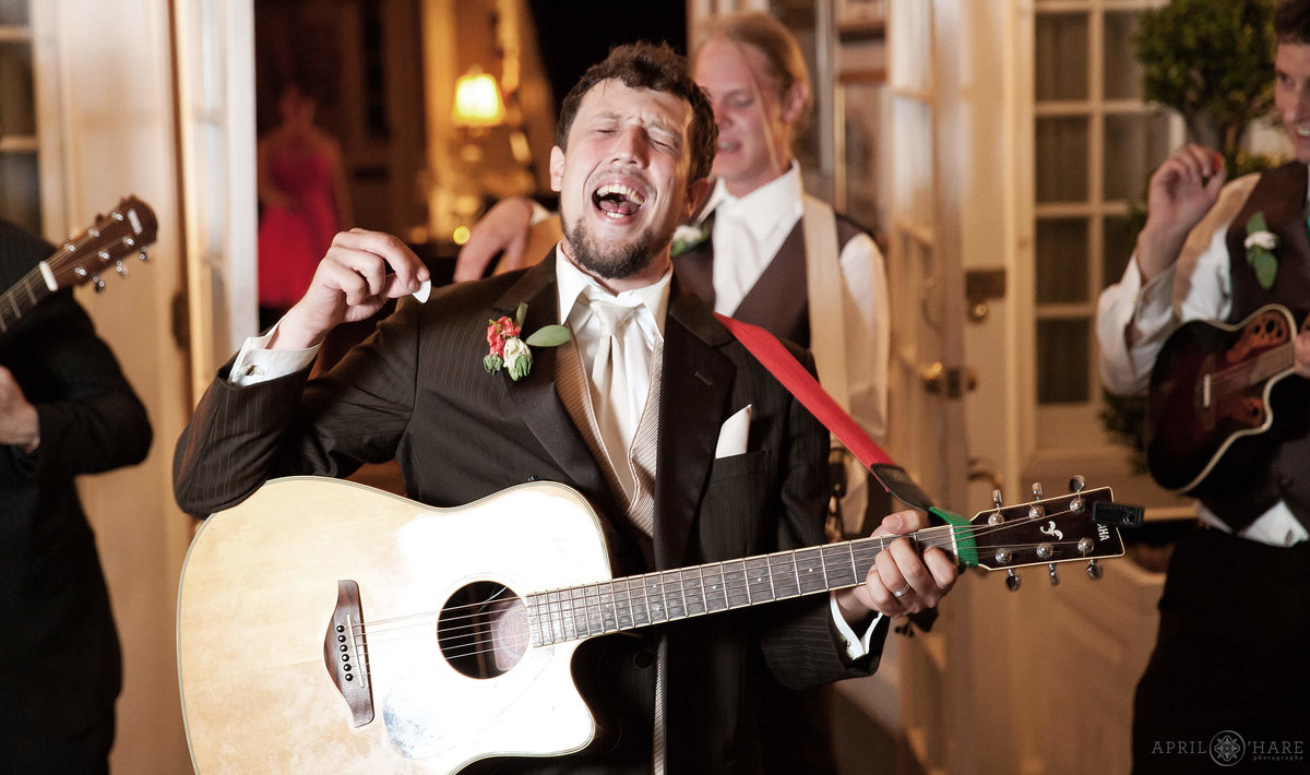 Groom singer in a band at The Manor House in Littleton Colorado
