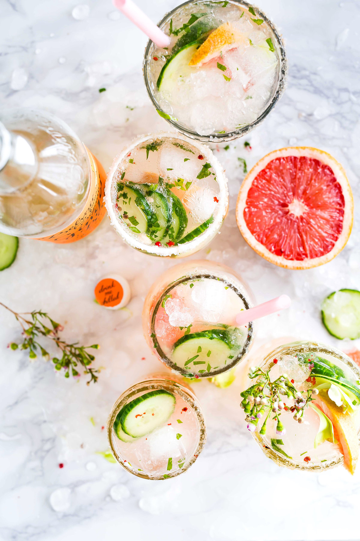 Brightly colored craft cocktails with cucumber & grapefruit