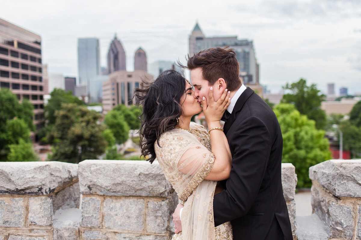 interracial wedding couple on a rooftop in atlanta georgia with city skyline in background