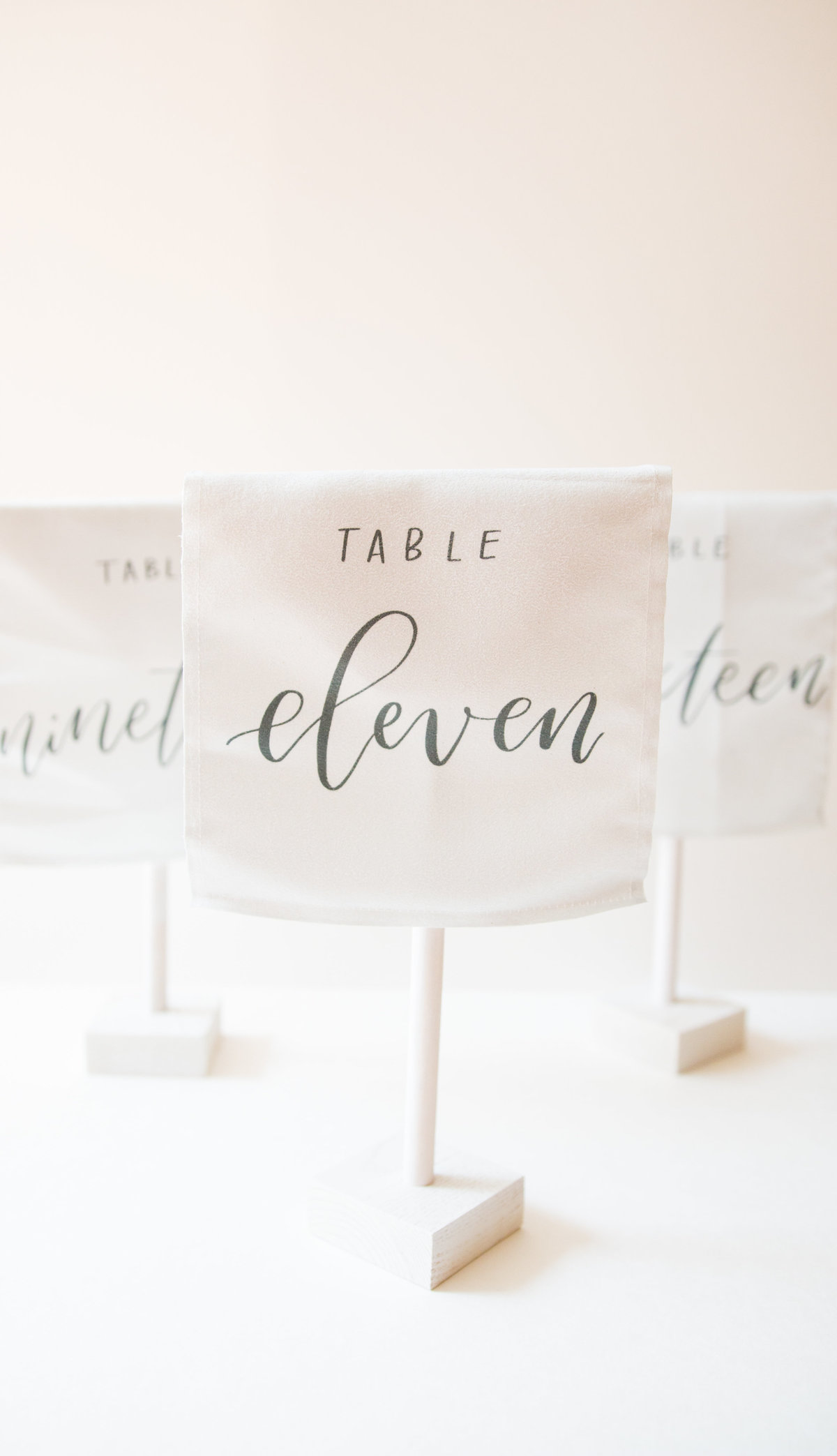White self standing velvet table numbers for weddings or events through Hue + FA rentals