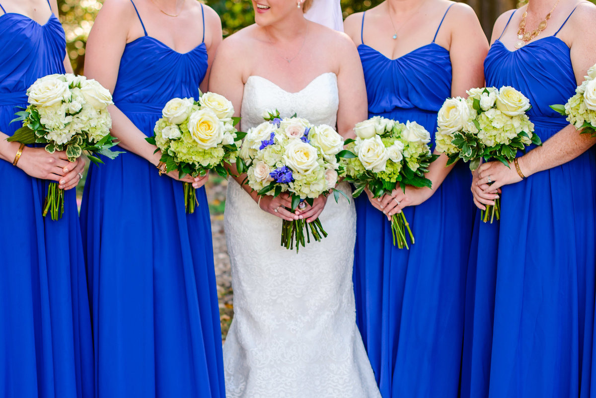 white, gold and blue wedding florals with hydrangeas