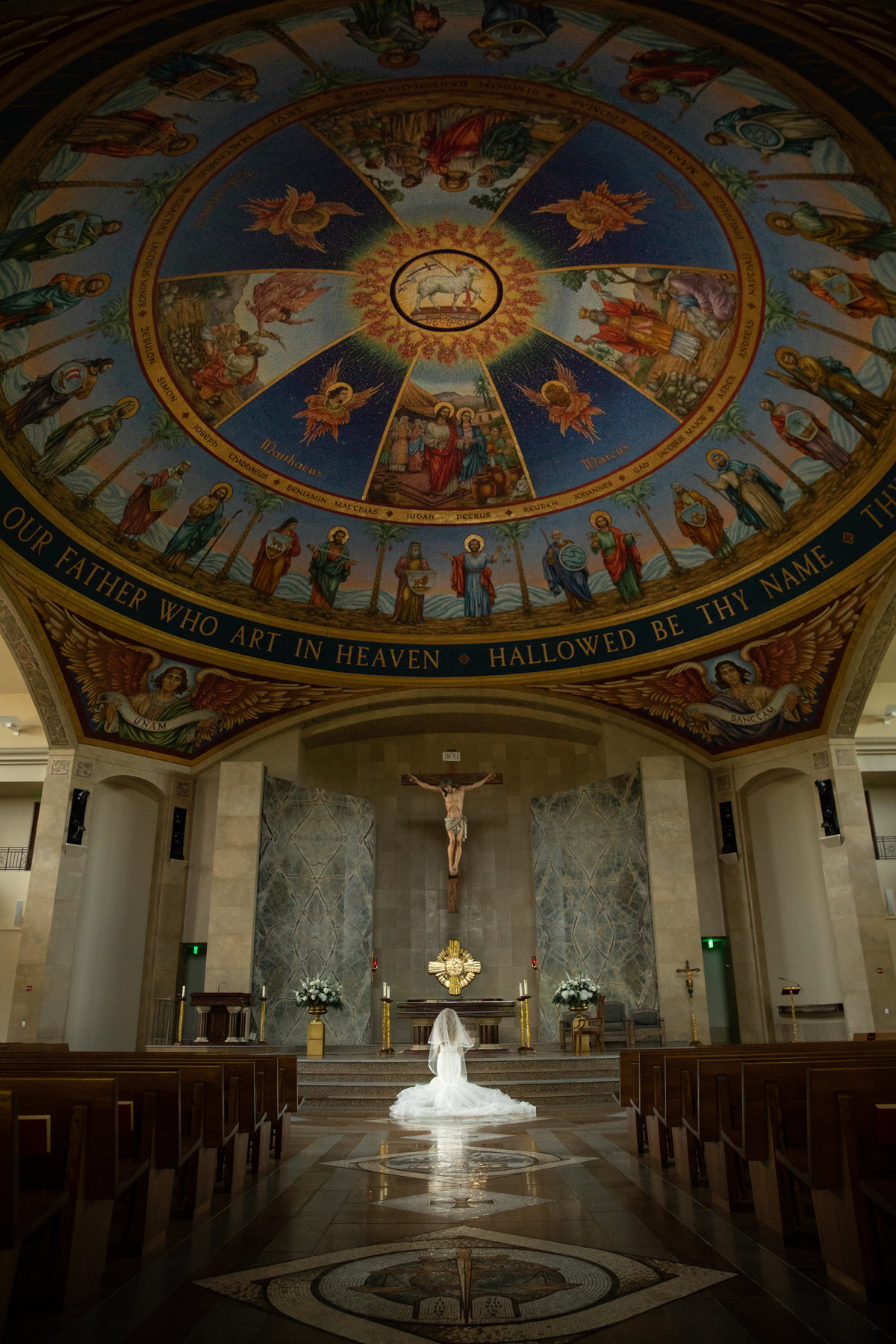 vintage villas wedding photographer bride catholic church praying alone 4209 Eck Ln, Austin, TX 78734