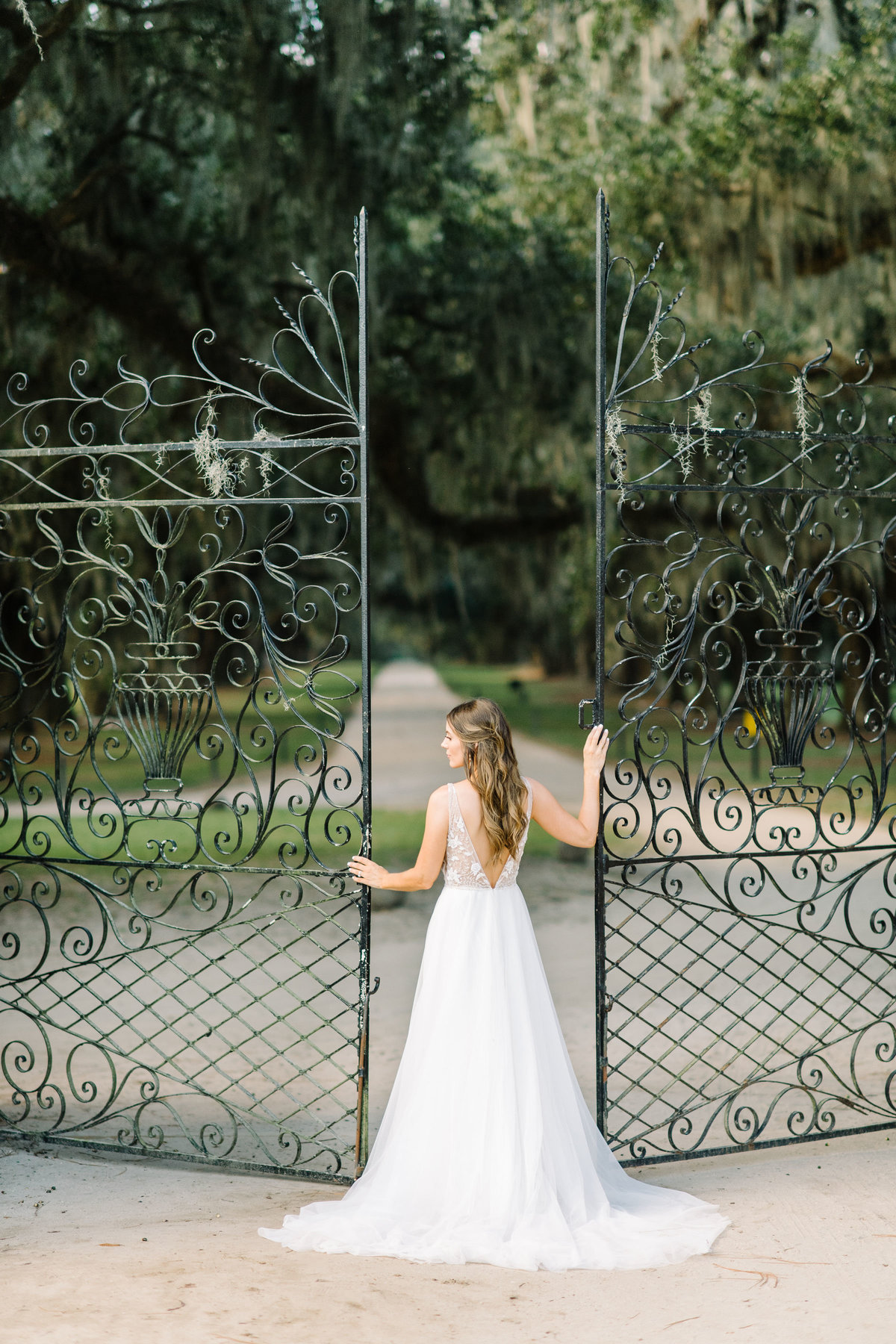 Bride standing at Boone Hall Planation Iron Gates