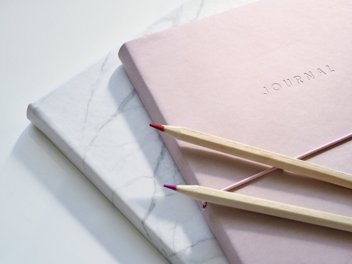Canva - Modern Minimalist Style Journals and Colored Pencils