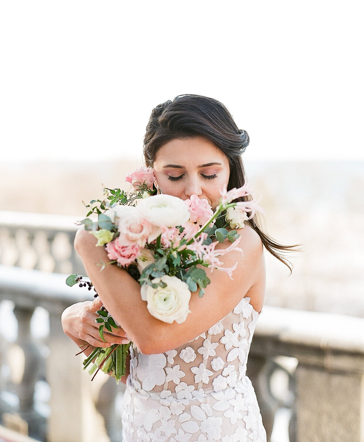 Bride posing with bouquet at Italian villa