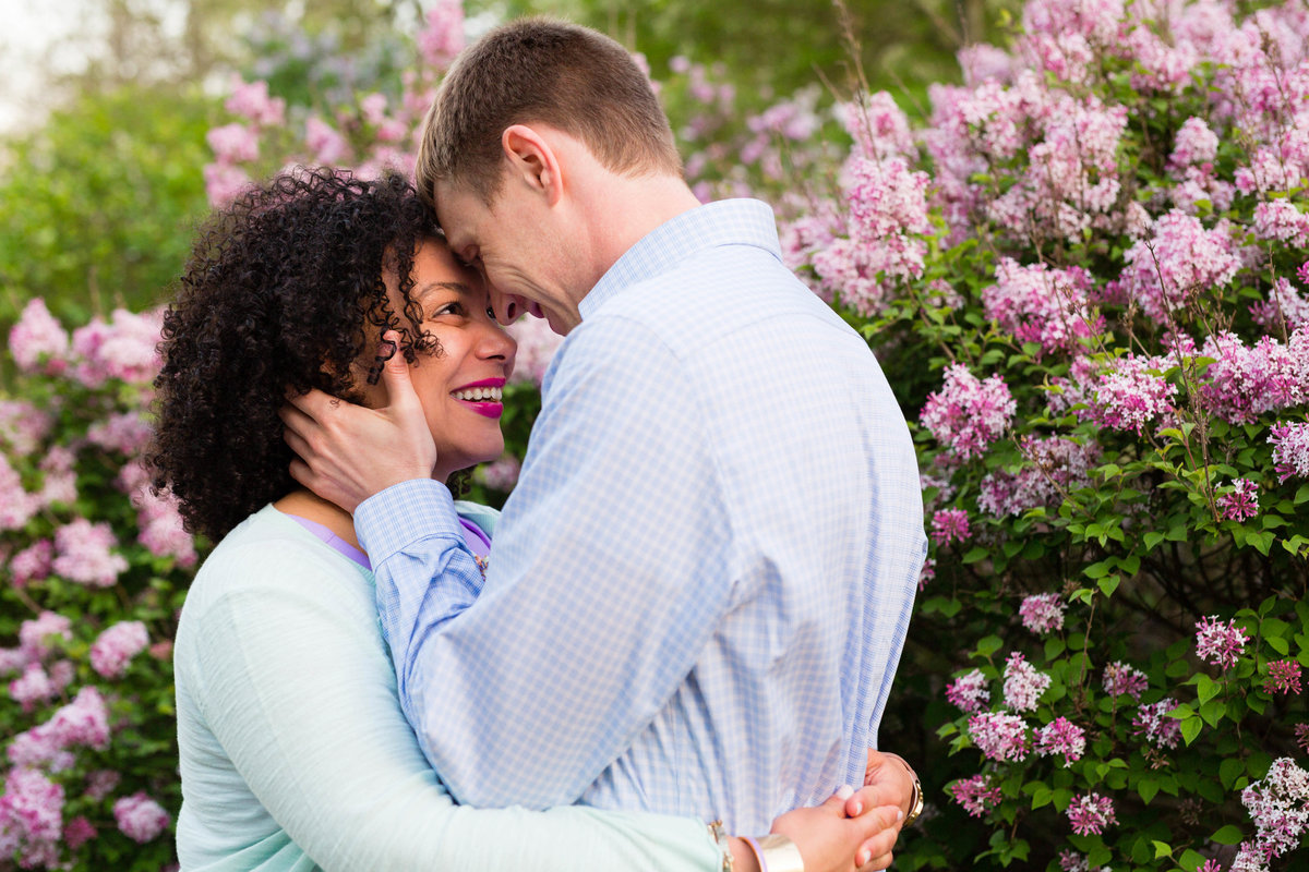 Arnold Arboretum in MA is the backdrop of this laughing couple at their engagement session