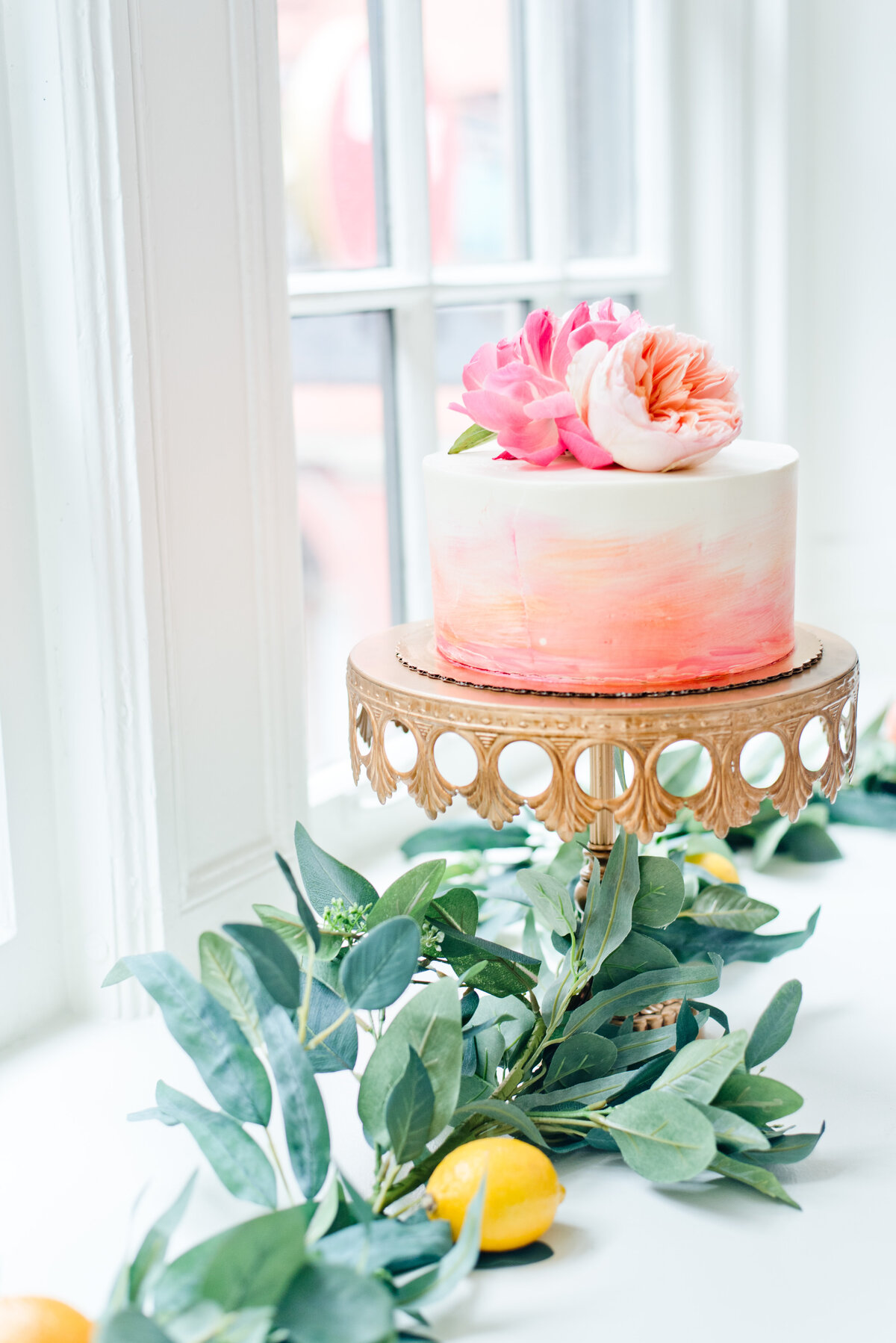 Greenery and colorful cake at Fort Worth wedding reception