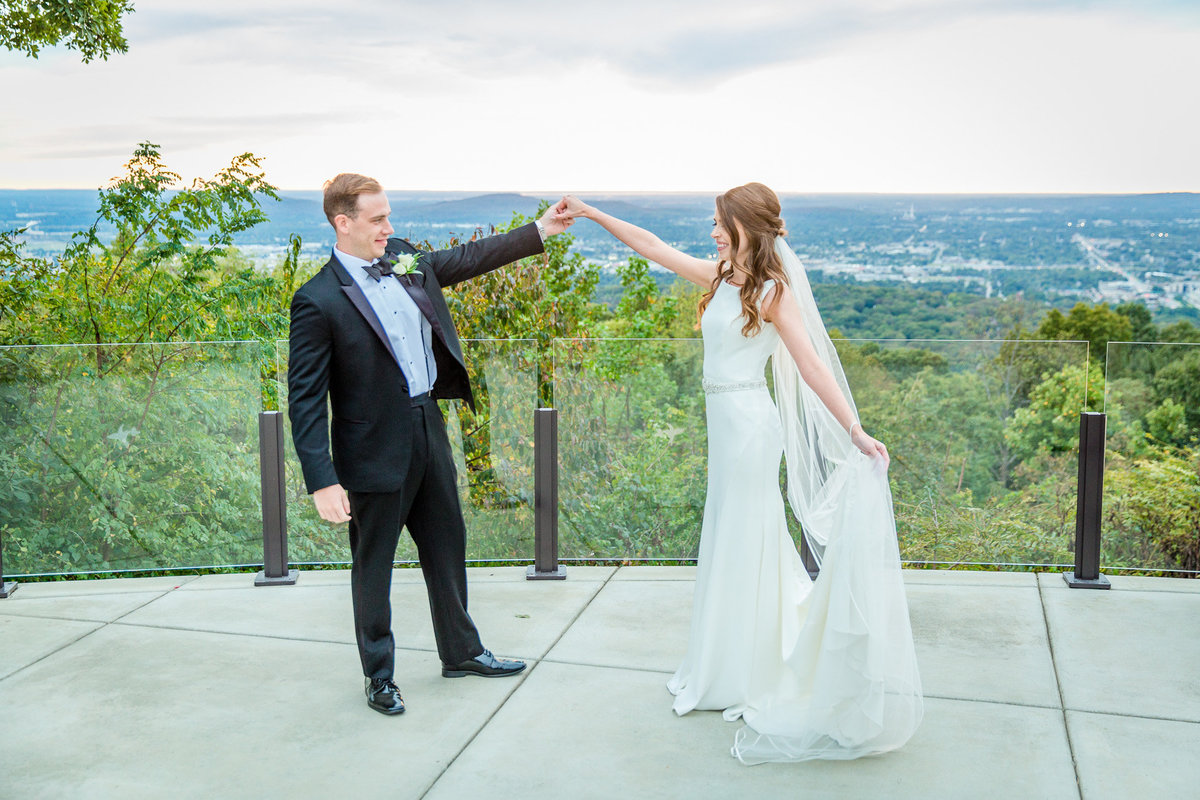Bride with a wind-tossed veil at Burritt on the Mountain