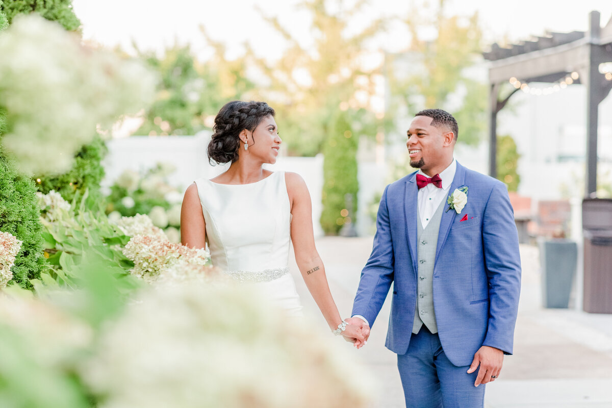 A black couple holds hands in a light and airy photo at Stratton Hall in Chattanooga Tennessee by Jennifer Marie Studios, Atlanta wedding photographer.