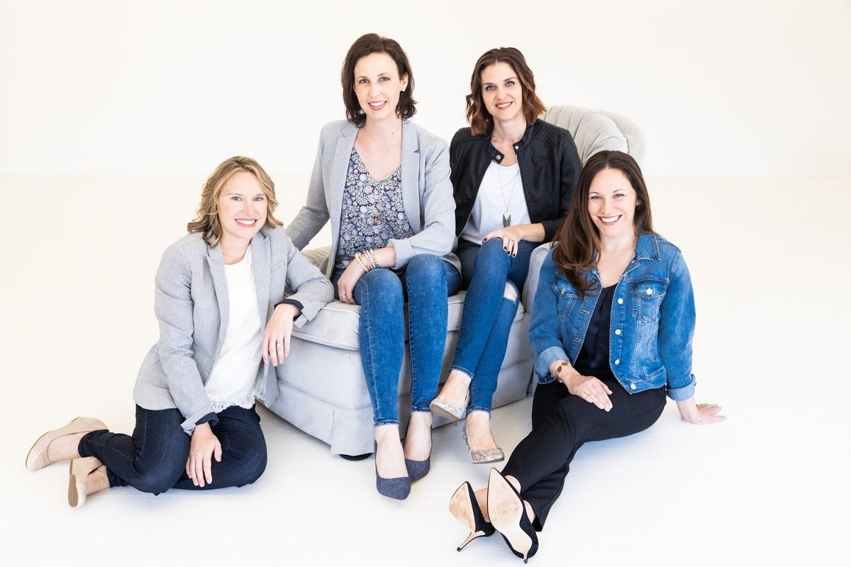 team of female entrepreneurs siit on couch at White Wall Studio Woodstock